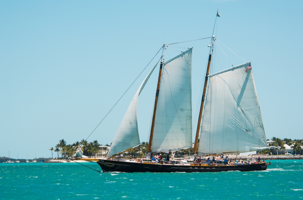 The Schooner America reefed and reaching through Key West Harbor
