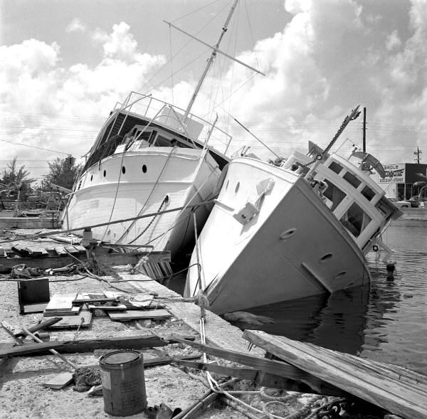 The aftermath of Hurricane Betsy at the Key West Yacht Club, circa 1965