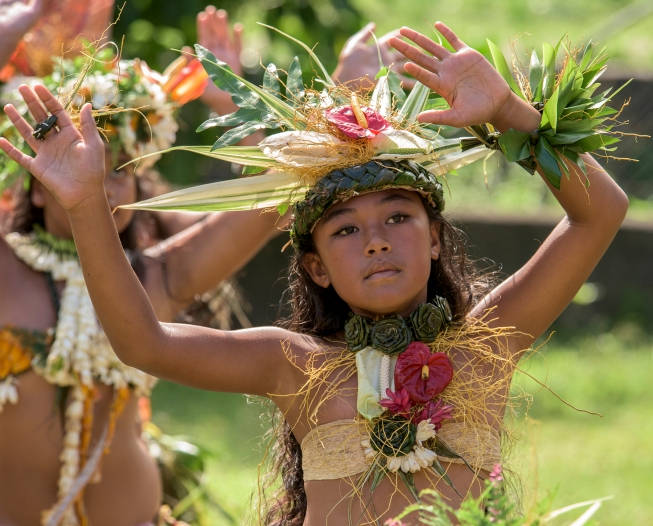 A schoolgirl performs a traditional Polynesian Haka dance during a presentation on the island of Fatu Hiva