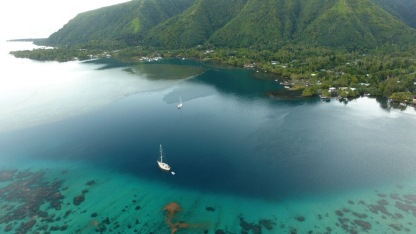Flying Fish is at anchor (foreground) in Vaianae Bay, Mo'orea. Photo: Skydive Tahiti