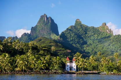 The Catholic Église de la Sainte-Famille in Ha'apiti, Mo'orea is set against a saintly backdrop