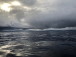 The water and sky become eerily calm before a South Pacific gale descends out of the Tasman Sea