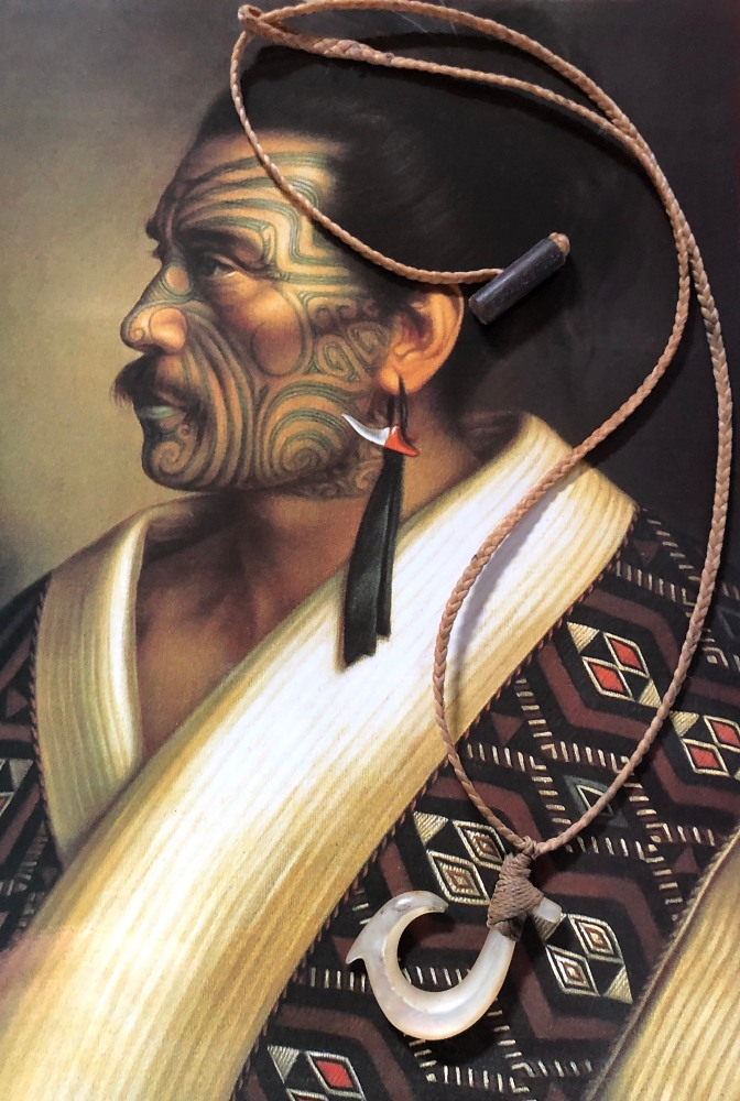 A portrait of an ancient Māori king and a hand-carved shell fish hook