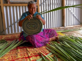Veisinia Falevia prepares pandanus leaves for weaving at her home in the Ha'apai Islands
