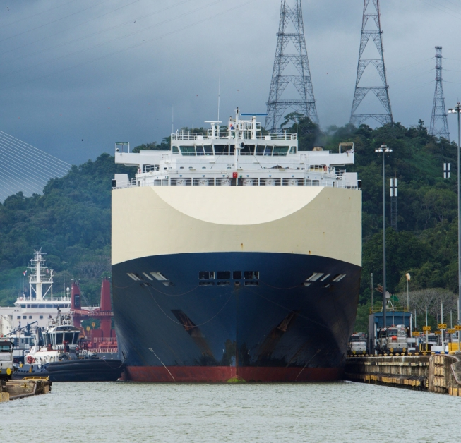 A massive container ship squeezes (by inches) into the Mirafllores Locks of the Panama Canal