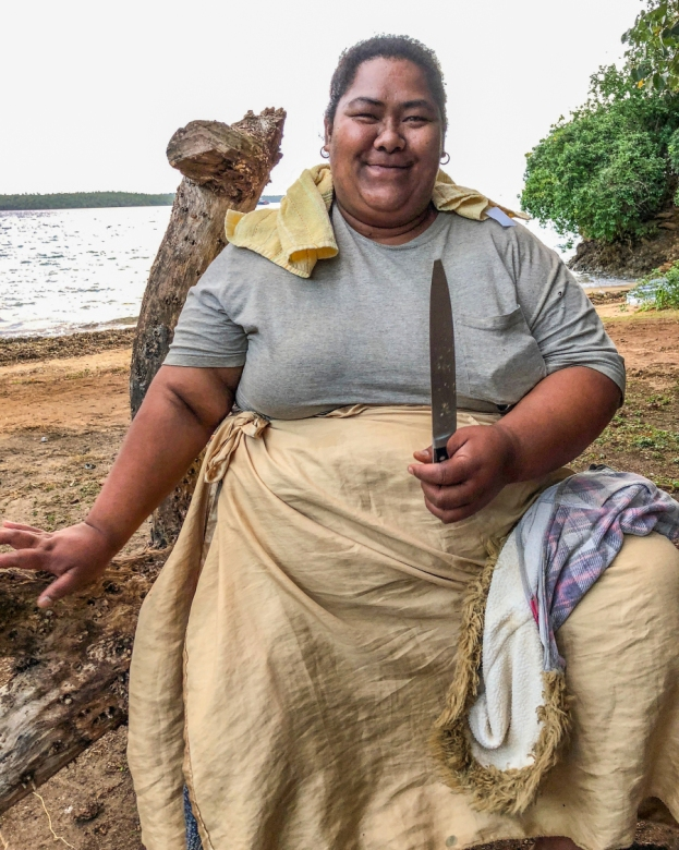 Laveni Tatafa from Nuapapu Island in a happy pose with her coconut husking knife